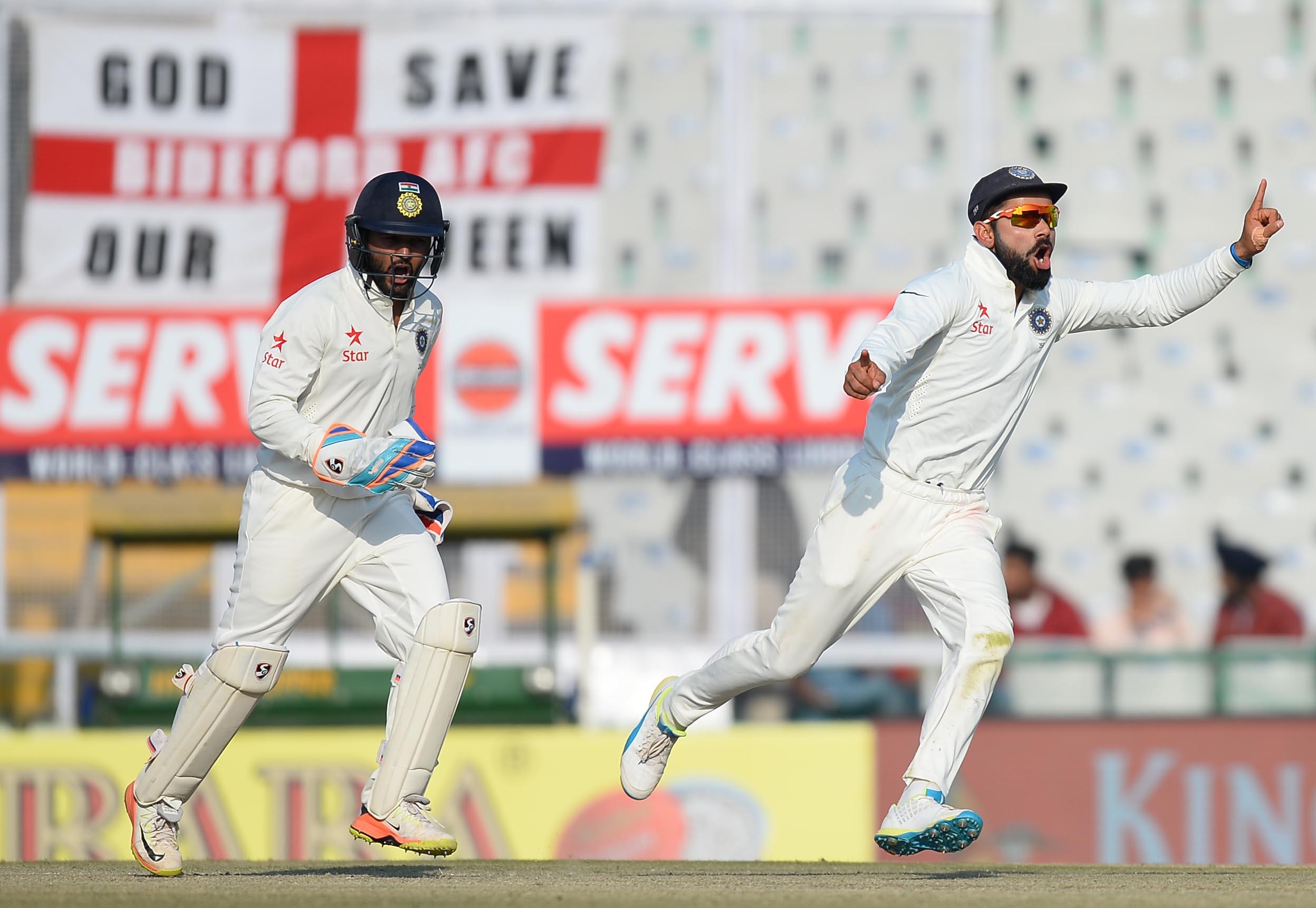Virat Kohli (R) and wicketkeeper Parthiv
