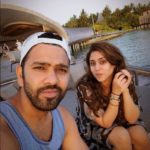 Rohit sharma chilling with her wife near ocean