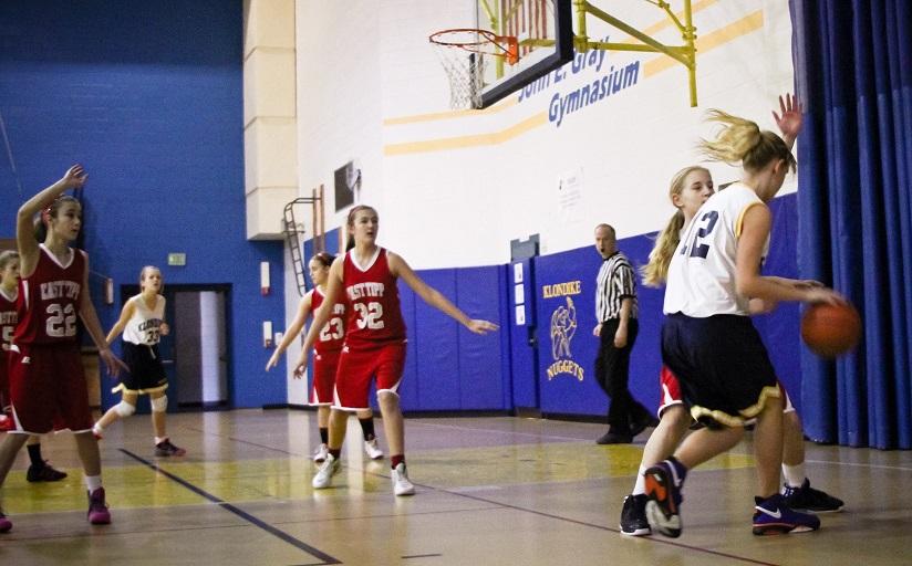 Assistant organizes basketball training camp for deprived children